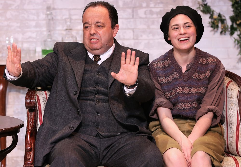 "Hugh Sachs (left) is Churton ""Chuffy"" Saunders, and Emily Laing is Pamela in J. B. Priestley's  The Roundabout . Top, from left: Lisa Bowerman as Lady Kettlewell, Laing, and Charlie Field as Farrington Gurney."