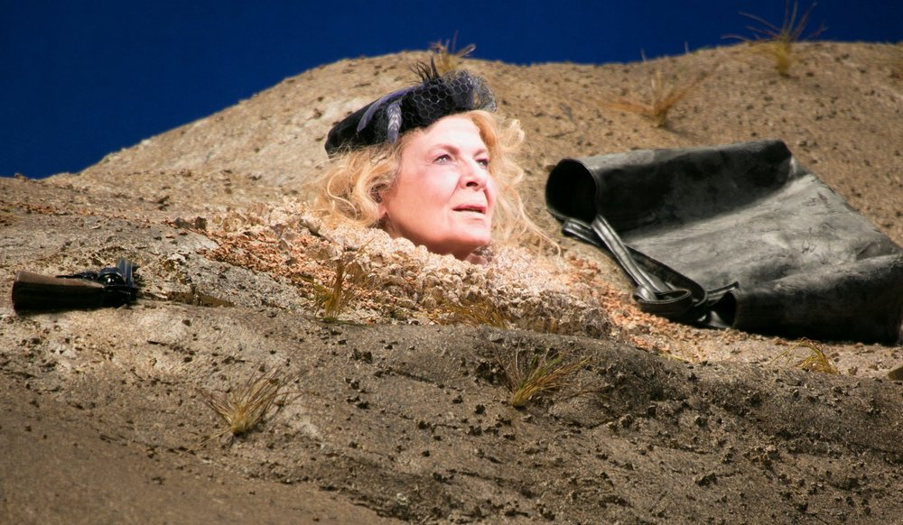 In Act II, Winnie is buried up to her neck. Photos by Gerry Goodstein.