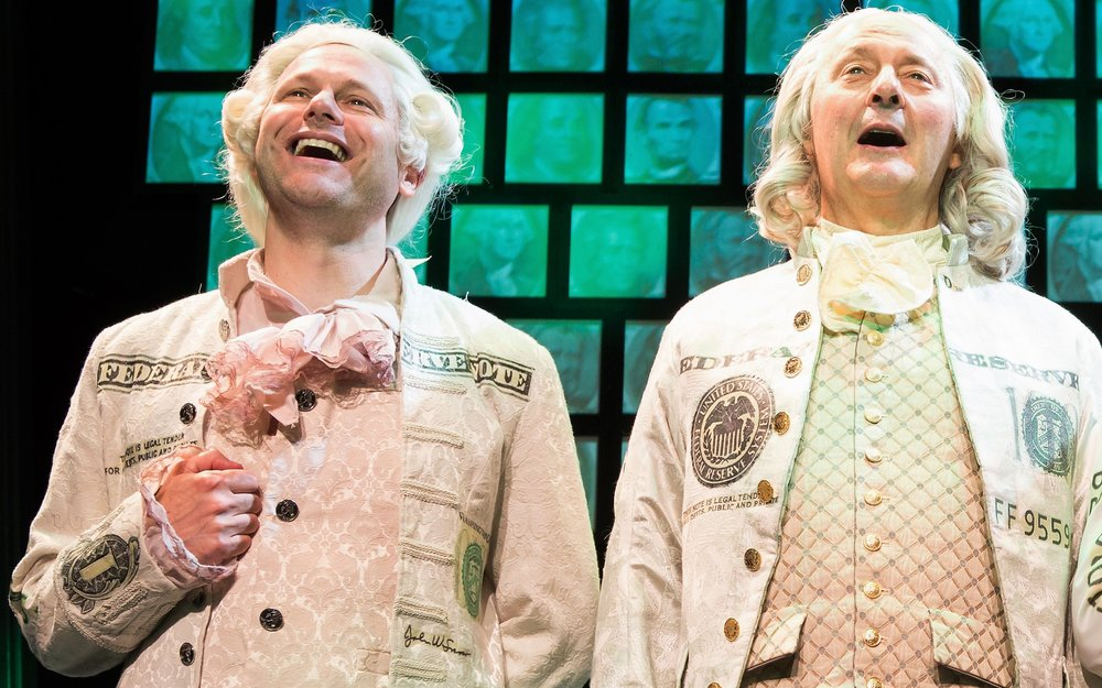 Merrick and Ralph Byers as Benjamin Franklin talk money in Money Talks. Photographs by Jeremy Daniels.