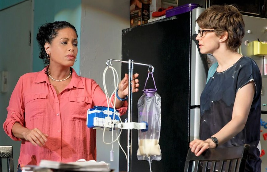 Liza Colón-Zayas (left) plays compassionate nurse Sherrie and Carrie Coon is the title character in Mary Jane in Amy Herzog's play Mary Jane. Top: Coon with Colón-Zayas as Dr. Toro.