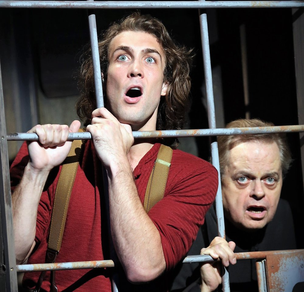 Conor Ryan as Johnny Blood (left) and Gary Marachek as Father Morse in  Desperate Measures . Top: Nick Wyman (left) as Governor von Richterhenkenpflichtgetruber and Emma Degerstedt as Susanna.