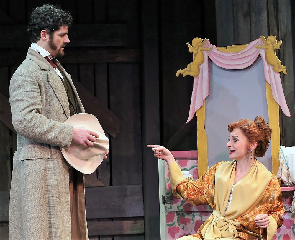 Saide as the sheriff with his love, Bella (Lauren Molina).