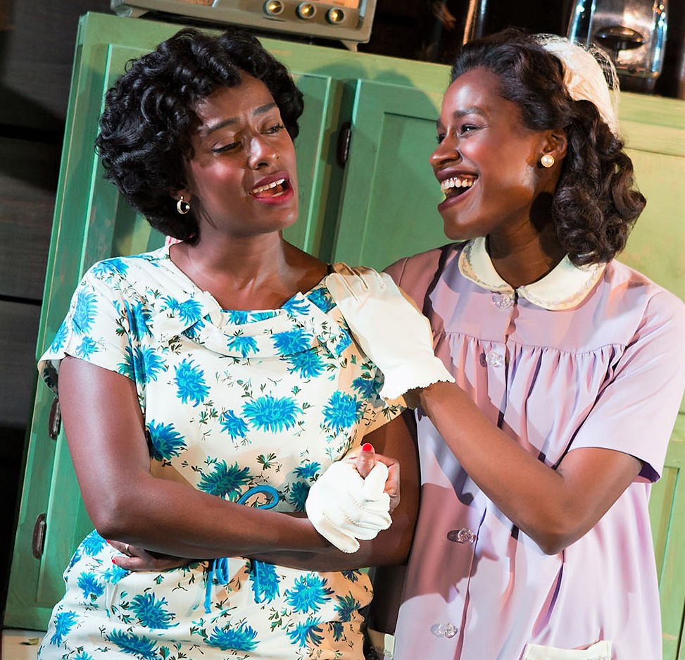 Eboni Flowers (left) as Evelyn with Okafor in Too Heavy for Your Pocket.