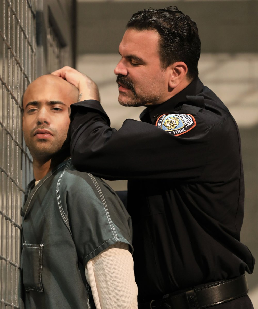 Sean Carvajal (left) is the prisoner Angel, and Ricardo Chavira is the sadistic prison guard Valdez in Stephen Adly Guirgis's  Jesus Hopped the 'A' Train . Top: Carvajal with Stephanie DiMaggio as Mary Jane.