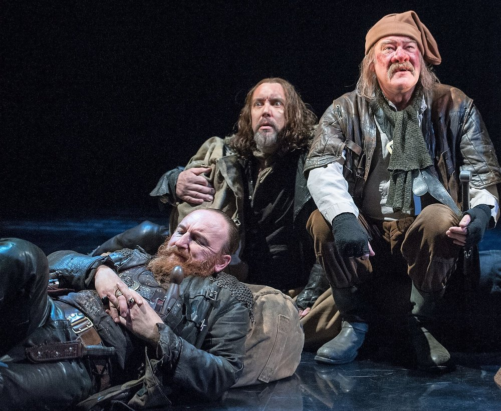From left: Antony Byrne as Pistol, Christopher Middleton as Nym, and Joshua Richards as Bardolph are the remnants of Falstaff's followers in Henry V. Top: King Henry V (Alex Hassell, left) listens to the Archbishop of Canterbury (Jim Hooper) elucidate his claim to the French throne.