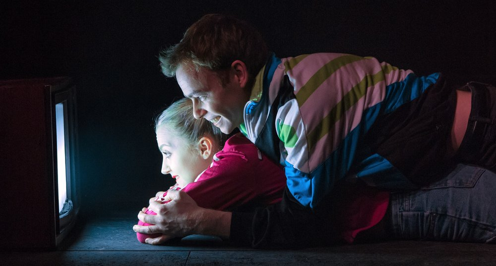 Evanna Lynch plays Runt and Colin Campbell plays Pig watching  Baywatch  in  Disco Pigs . Top: Campbell, left, and Lynch in Enda Walsh's play.