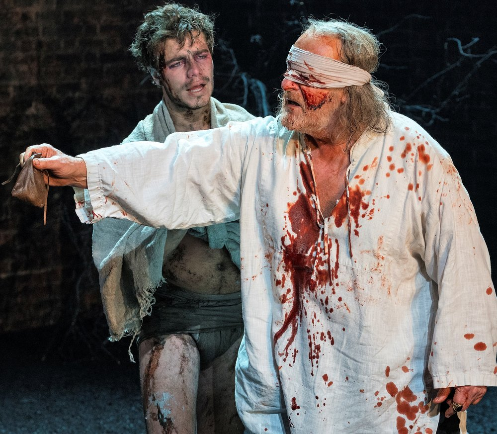 Oliver Johnstone (left) is Edgar, and David Troughton plays his blinded father, the Earl of Gloucester, in  King Lear . Top: Antony Sher as Lear rails against his oldest daughter, Goneril (Nia Gwynne), as Kent (Antony Byrne, left) looks on.