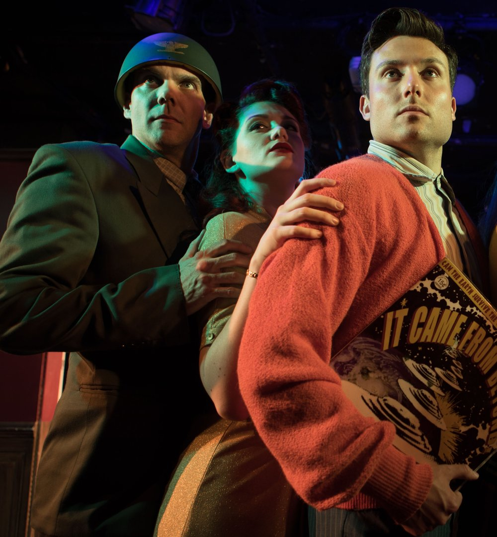 From left: the Colonel (David R. Doumeng), Jayne (Kaitlyn Baldwin), and Henry (Clint Hromsco) stand tall in  It Came From Beyond . Top: Hromsco, foreground, with Bryan S. Walton and Kayleen Seidl. Photographs by Adam Smith, Jr.