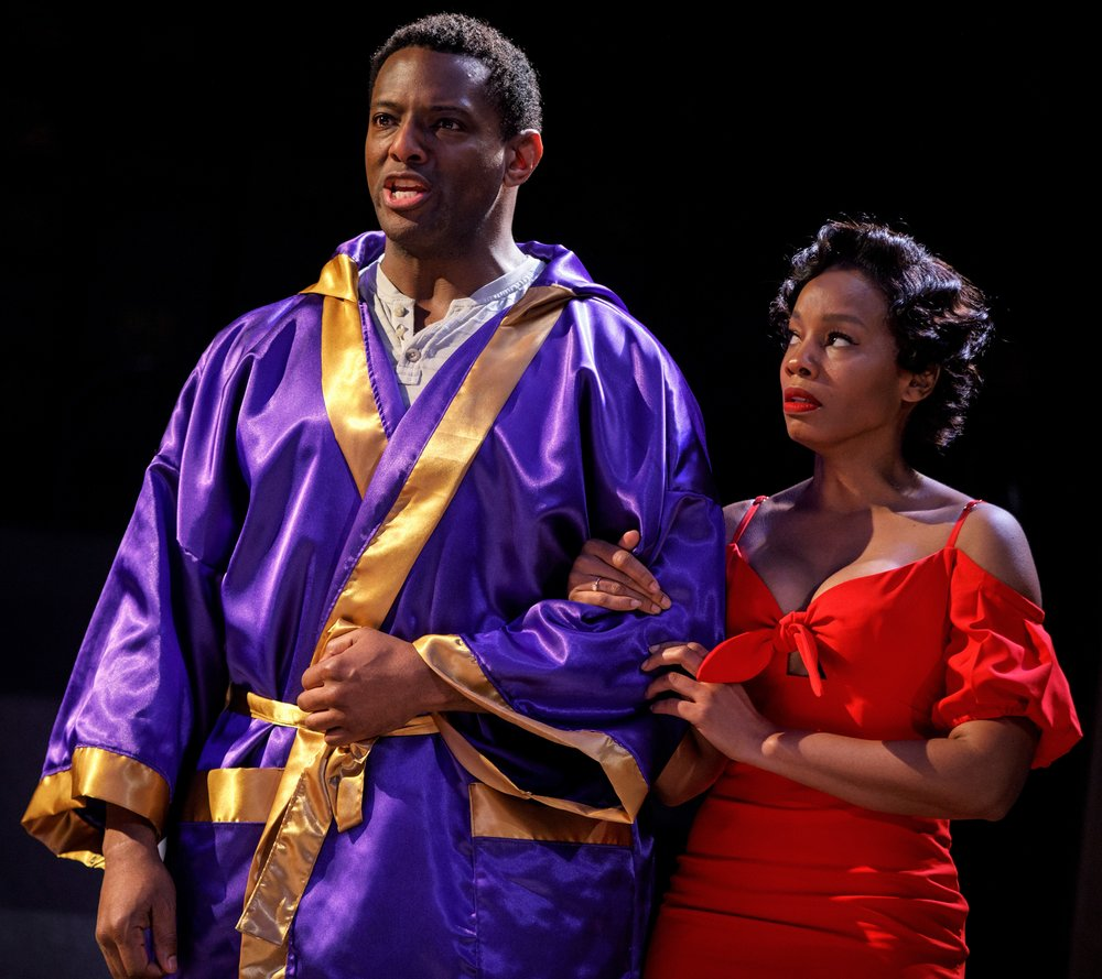 David Aron Damane is Husky Miller and Anika Noni Rose is the gold-digging seductress Carmen in  Carmen Jones , Oscar Hammerstein II's reworking of Georges Bizet's opera  Carmen . Top: Rose with Clifton Duncan as Joe.