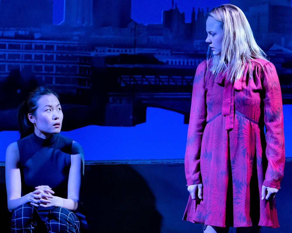 Karoline Xu (left) is Bo and Adelaide Clemens is Hilary in Tom Stoppard's  The Hard Problem.  Top: Clemens with Chris O'Shea as Spike.