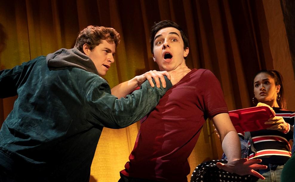 Dwayne (Jake Levy) menaces Simon (Kyle McArthur). Top: Charlotte (Kate Baldwin) on a sort-of-date with Jim (Bryce Pinkham).