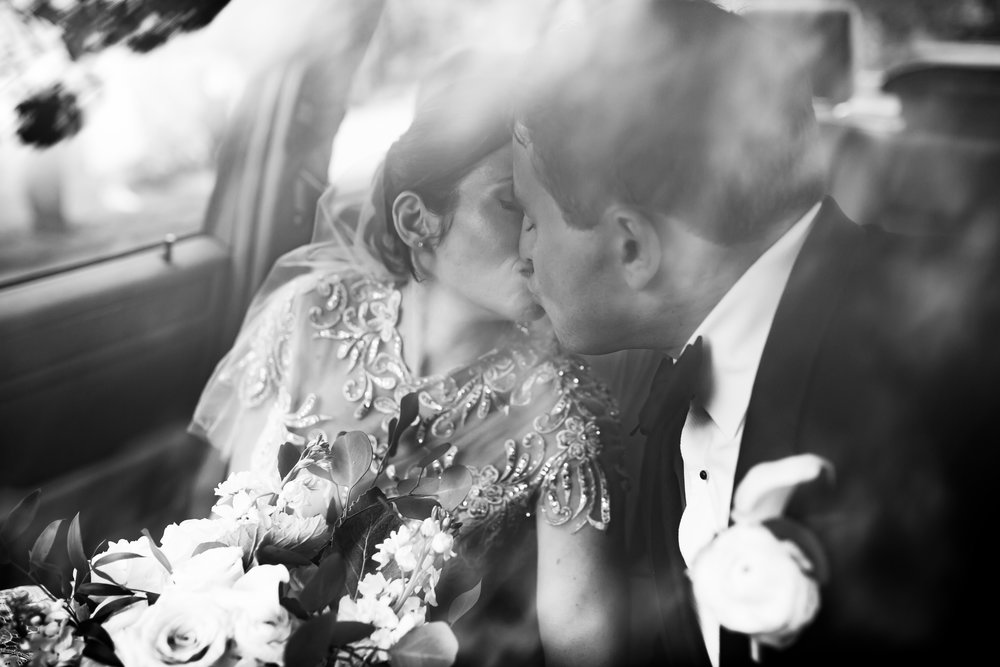 married couple kissing wedding photo