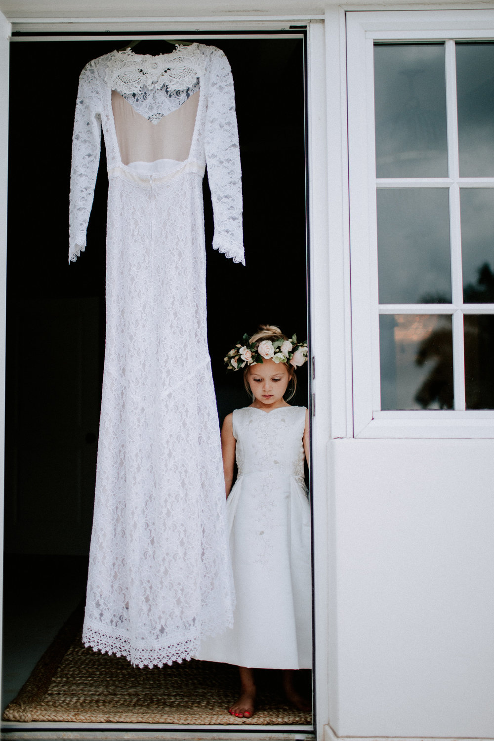 flower girl with her moms dress