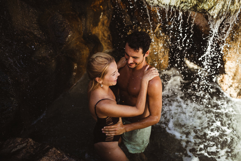 couples in a waterfall in mexico