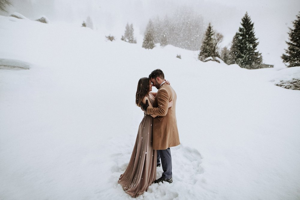 Switzerland engagement photo in the snow