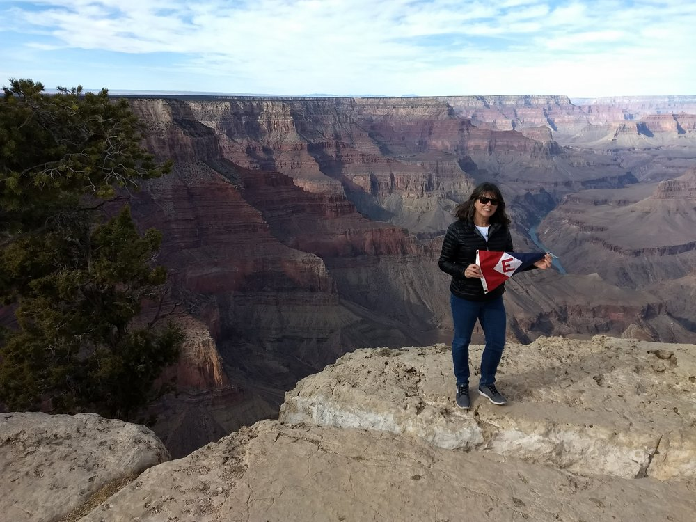 Karen Nousen proudly showing the EYC colors at the Grand Canyon.