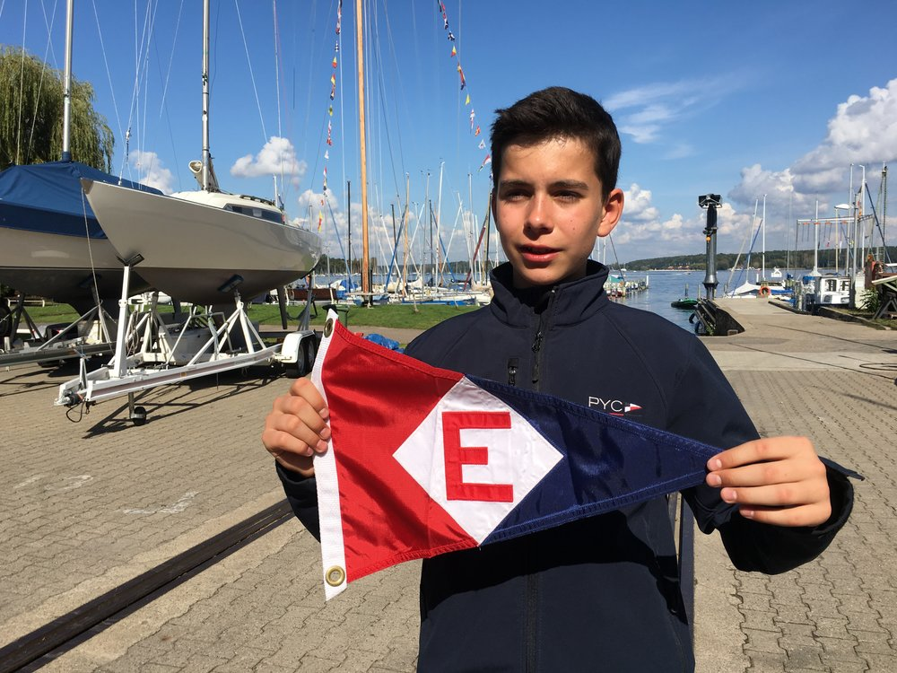 Hendrick and his mom Sigrun visited our club last summer and exchanged burgees with from their club with EYC. Here's Hendrick at Potsdamer Yacht Club in Germany showing our colors.