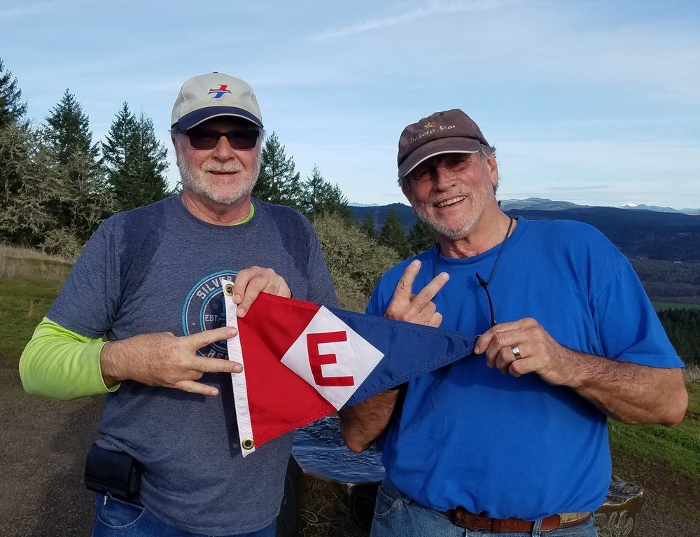 Murray McLeod and Scott Landgreen with the EYC burgee on the top of Mt. Pisgah.