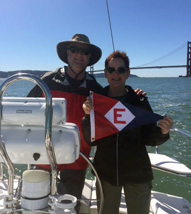 Bob and Suzanne Pritchard hoist their EYC colors in San Francisco Bay.