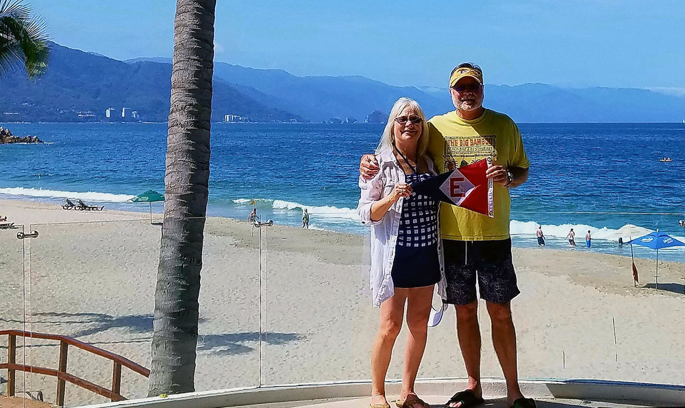 Murray and Linda McLeod show their EYC pride on a sunny beach in Puerto Vallarta, Mexico.