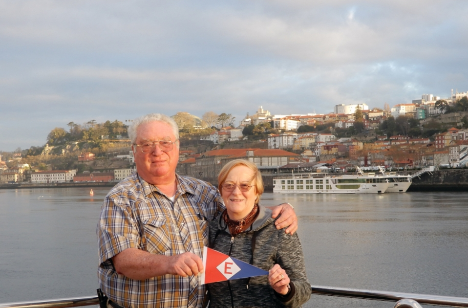 Keith & Joan Dunlap fly the EYC colors on the Douro  river in Porto, Portugal.