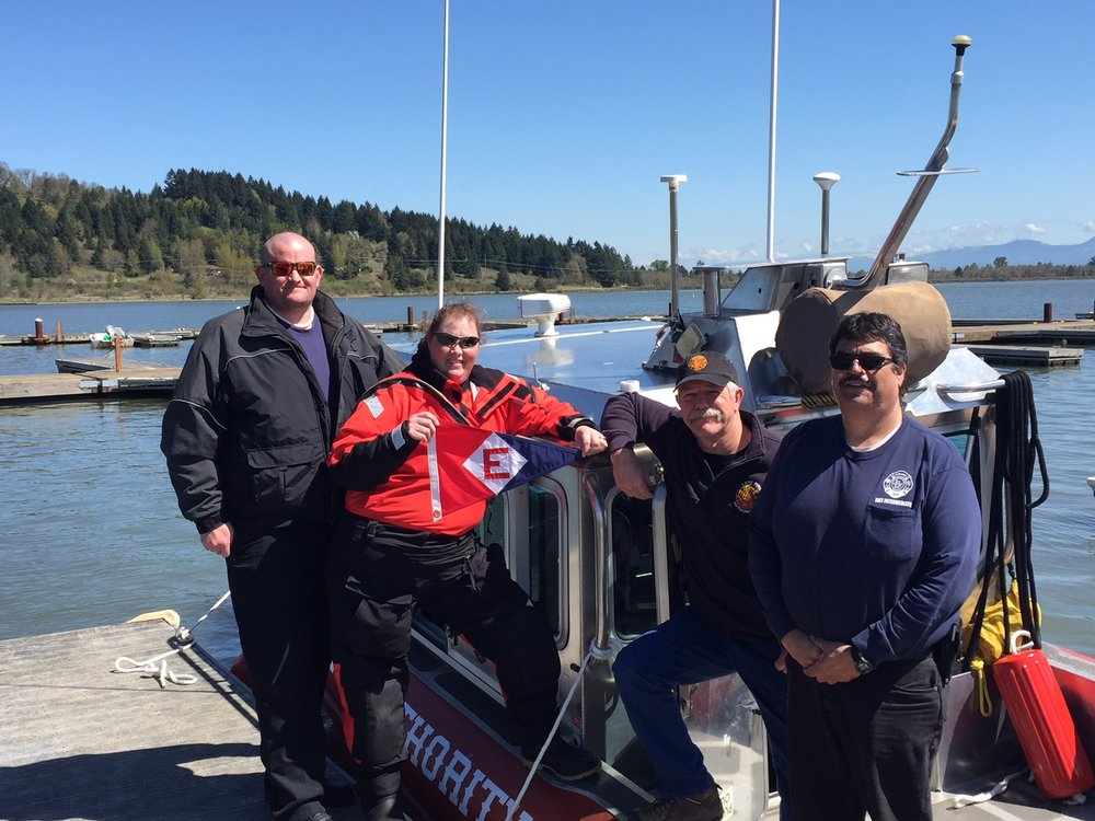 Crew from the Lane Fire Authority sport the EYC burgee.