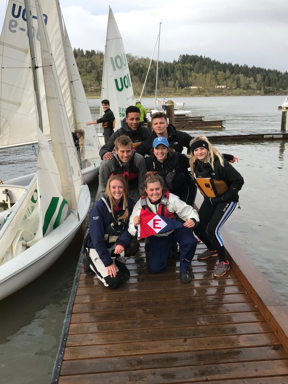 The UO Sailing Team takes a break from practice to show the EYC colors. Go Ducks!