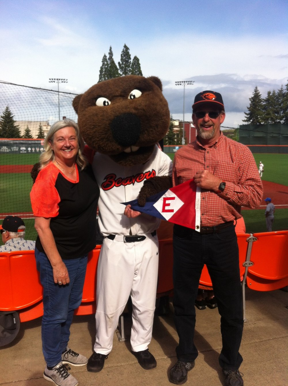 Mary and Chip Balough share some spirit with Benny Beaver at an Oregon State baseball game.