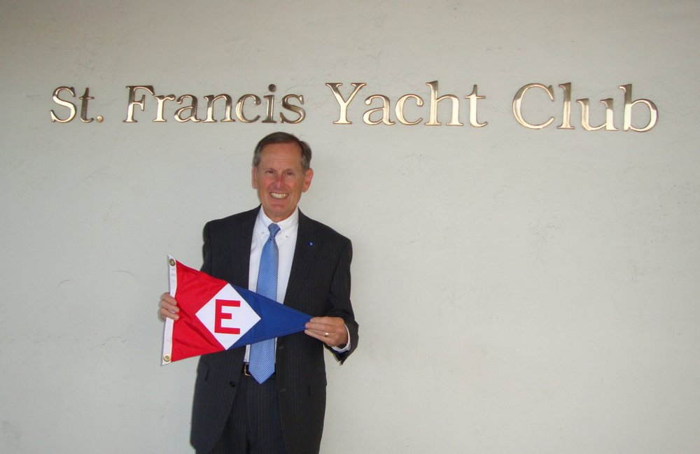 Commodore Gary Powell shows the EYC colors prior to a burgee exchange with St Francis Yacht Club in San Francisco, CA.