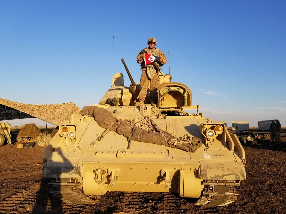 Michael Tieman shows his colors atop his 'land yacht' during training near Boise, ID.