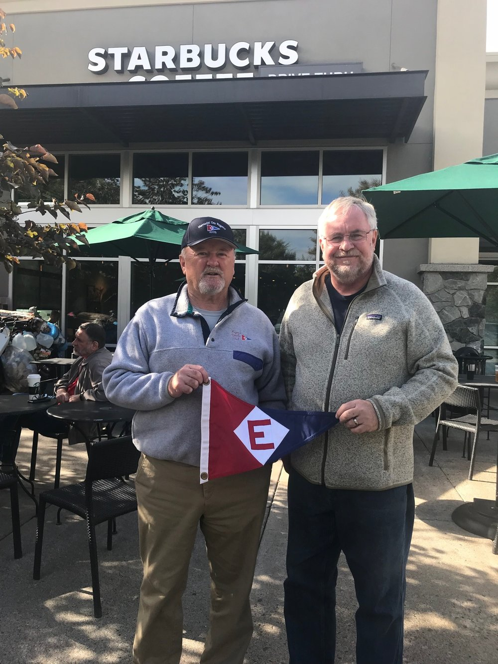 Rex Ballenger and Richard Johnson take their burgee out for a cup of coffee