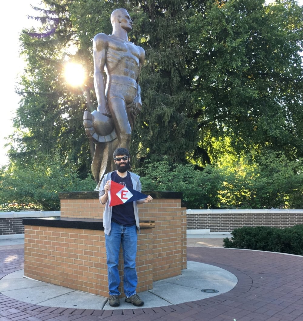 Alex Aaring, son of Rich & Dixie Aaring, shows a little EYC pride at the foot of The Spartan on the Michigan State campus