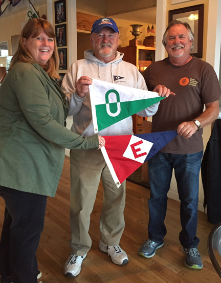 Rex Ballenger exchanges burgees with past Oceanside Yacht Club commodores in California.