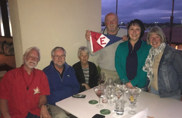Ken, Richard, Bonnie, Rex, Marie, and Chris gather at Tommy Bahamas in Palm Desert, CA to raise the colors