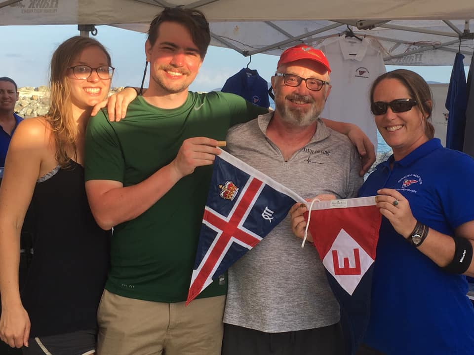 Kimi, Jac, and Chris make a burgee exchange with Royal BVI Yacht Club manager Tamsin Rand.  The EYC  burgee will be the first new one to grace their new club house after Hurricane Irma.