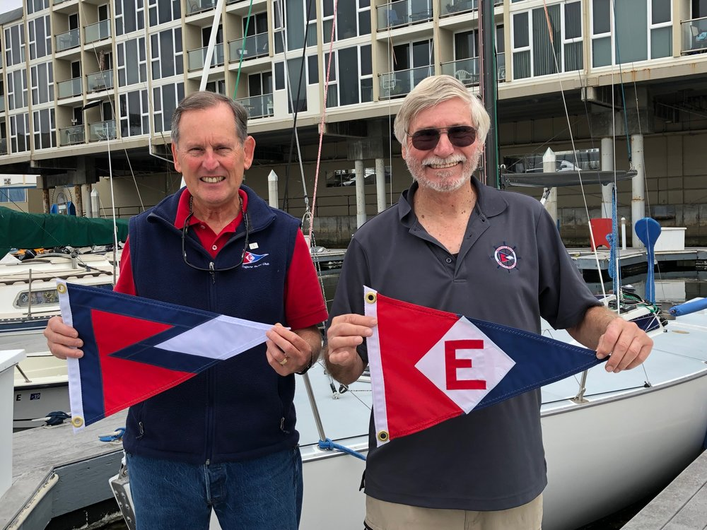 Gary Powell exchanges burgees with the Commodore of the Redondo Beach Yacht Club in California
