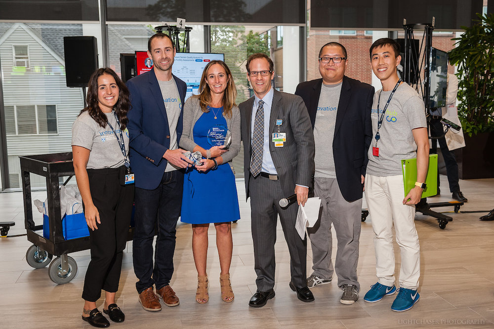"Brigham Digital Innovation Hub team with ""Disrupting Medicine"" award winner Lesley Solomon, MBA and Brigham Health CIO, Adam Landman, MD:  Lightchaser Photography / J. Kiely Jr."