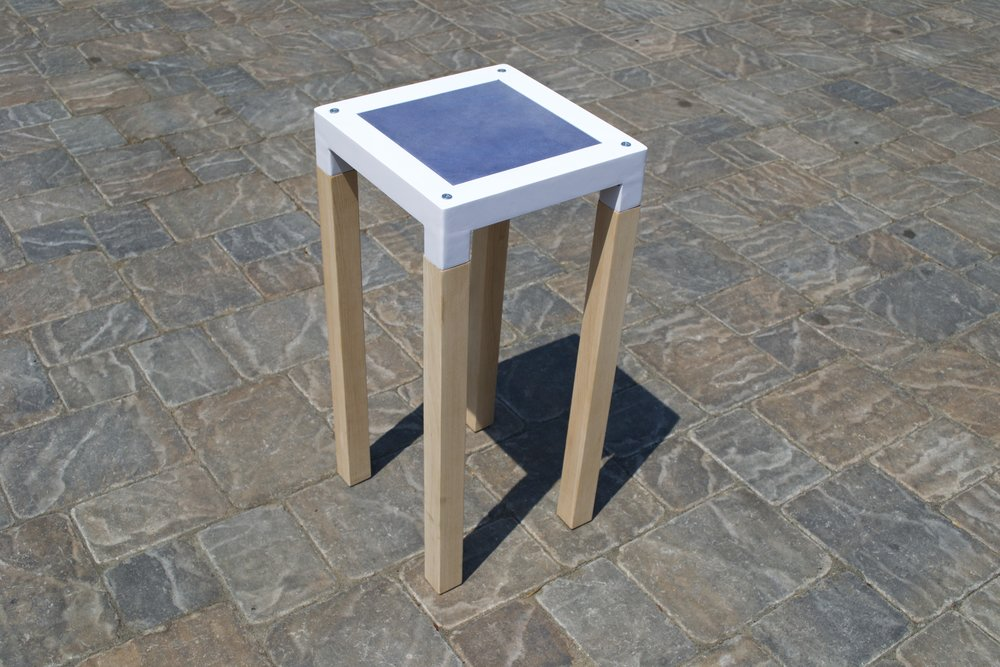 Stool 01 Steel frame, white powder-coat finish.  Maple legs.  Lavender goat-skin seat