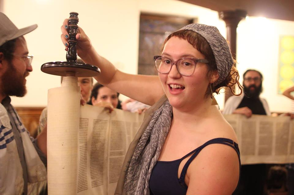 Holding a Torah scroll at Simchat Torah, October 2017 at Kol Tzedek Synagogue in Philadelphia, PA