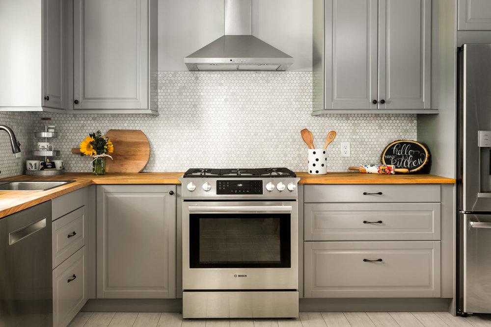 Full Kitchen with Wood Countertops and Honeycomb Backsplash Tiling