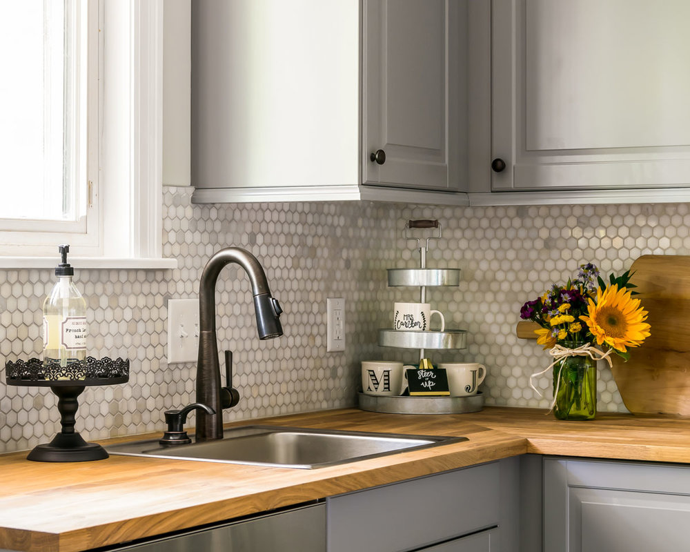Kitchen Window View with Modern Sink and Honeycomb Tiles