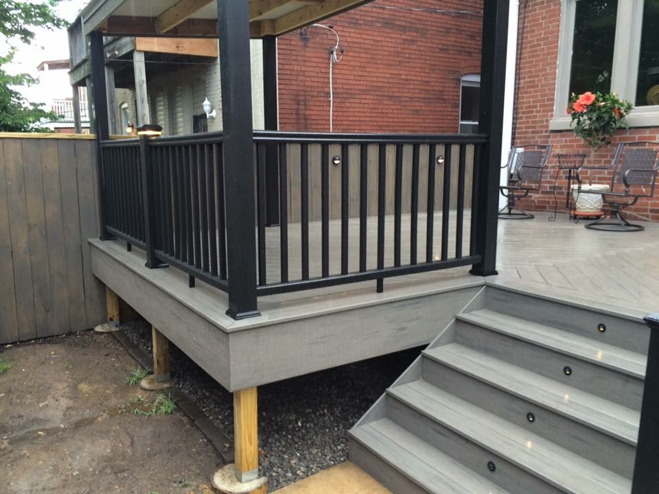 Grey Outdoor Deck with Black Fence