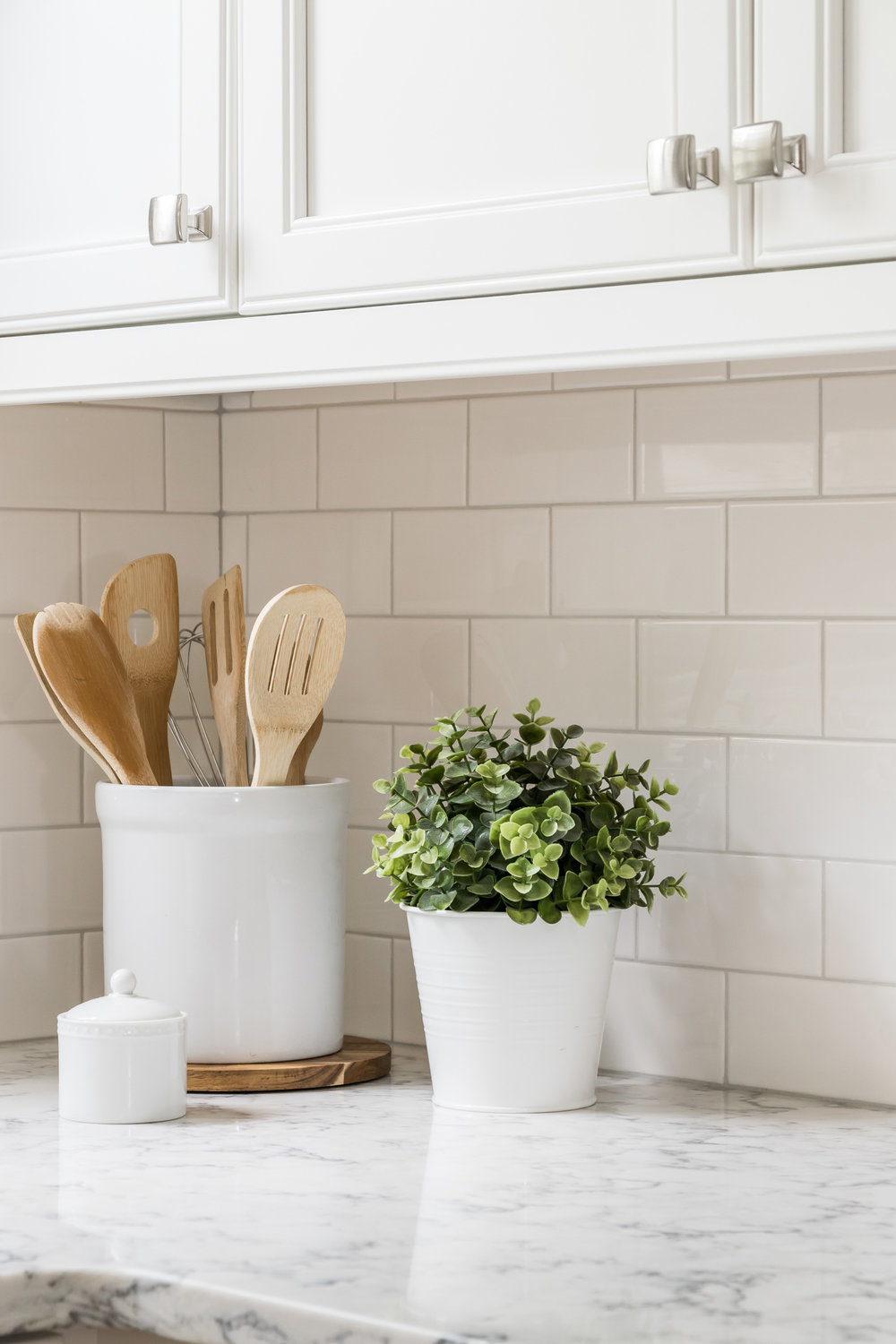 Marble Countertop with White Cabinets