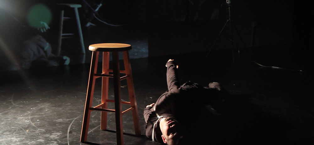 SOLITUDE, WITH EYES WATCHING 10 mins //First Showing>> April 4th, 2015 at On the Boards (OPEN STUDIO), Premiered>> September 26th, 2015 at Velocity Dance Center One human. One stool. Two cameras. 10 minutes. This is a physical interrogation.