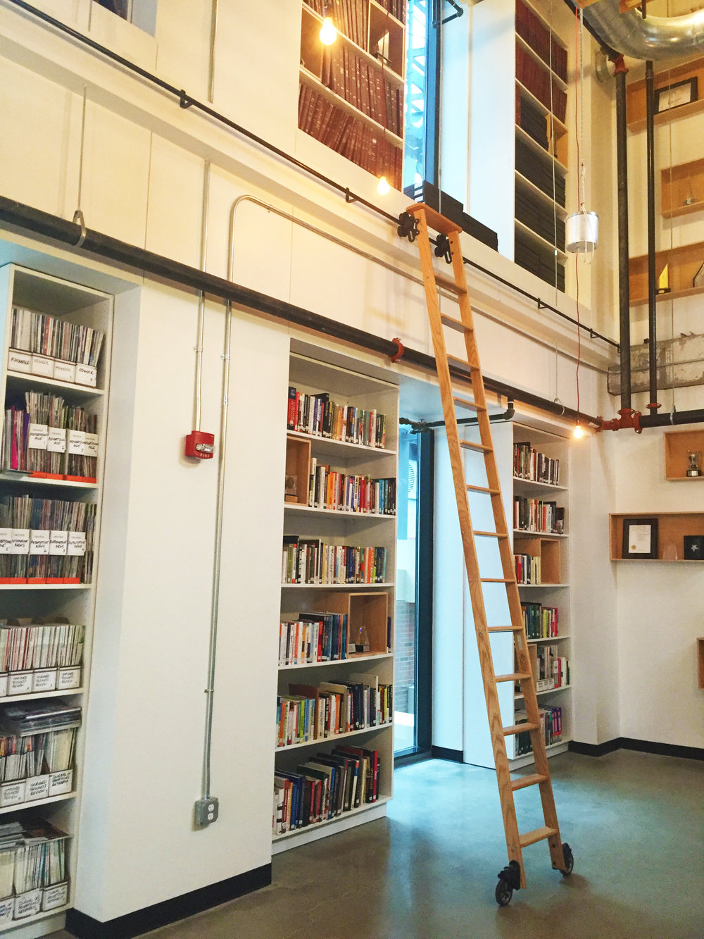 The interiors of the Campbell Ewald headquarters were very industrial, which made it really feel like it fit into the urban landscape of Detroit. This is their library.