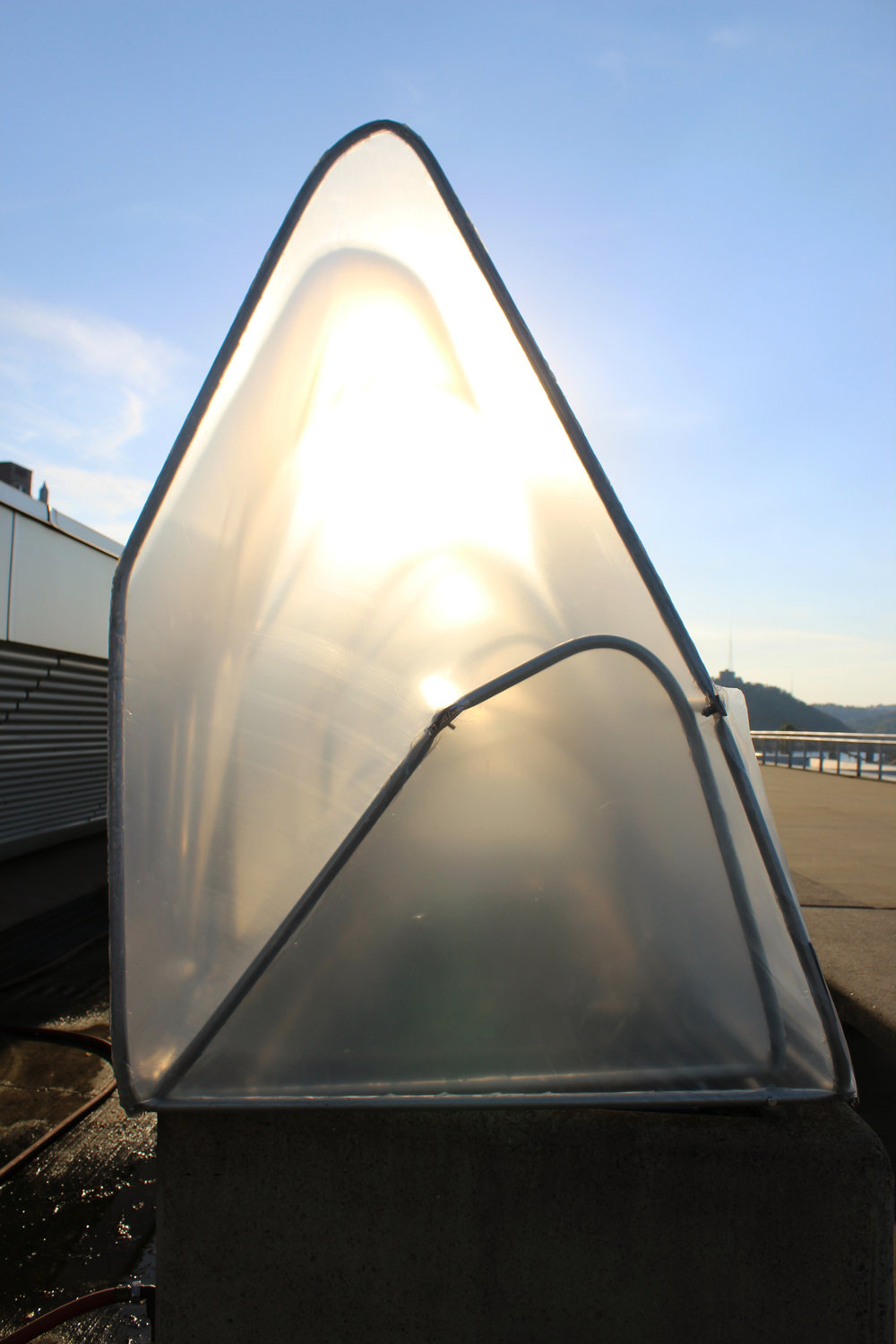 With the sun shining though our hoop house, you can really see the double layer design.
