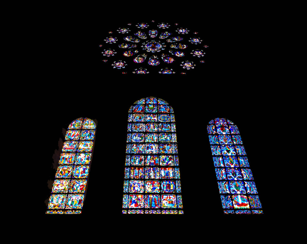 The cathedral at Chartres is known for its stained glass. This is one of its three rose windows, with lancet windows below depicting (from left to right) Christ's death, birth, and the Tree of Jesse.