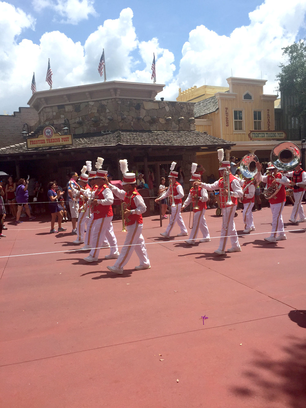 I love that the parade starts with an old-school marching band! It just brings Main Street to life!