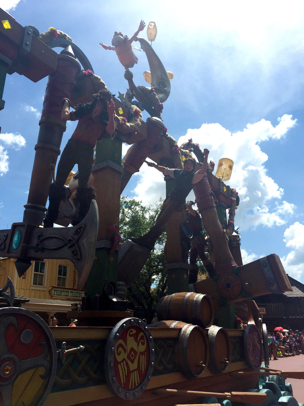 Flynn Rider and the thugs swing on giant hammers and axes. Doesn't Flynn look like he's having a blast?