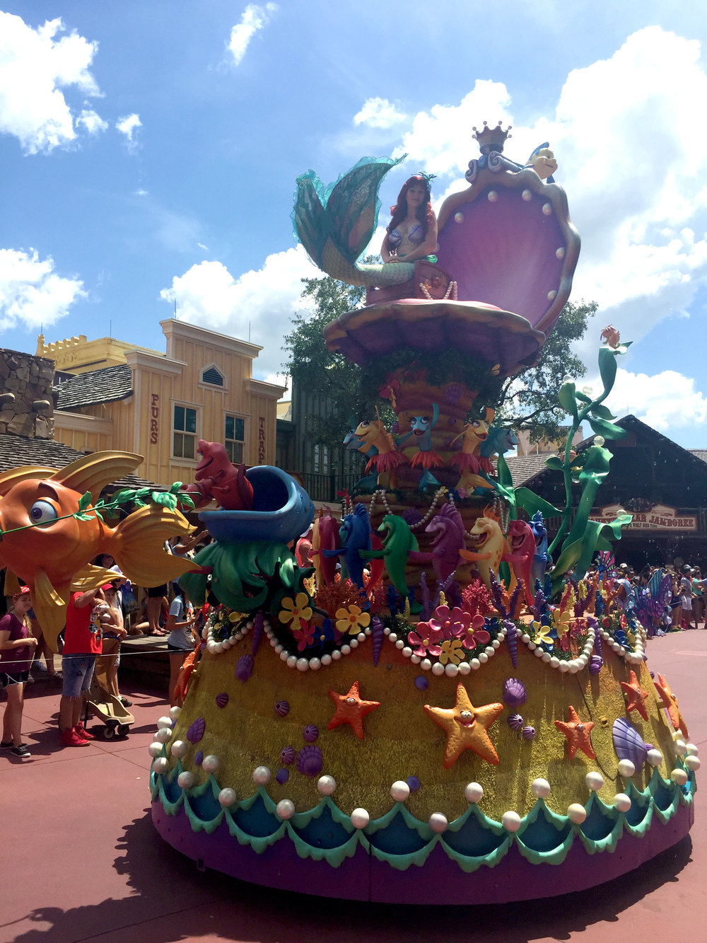 Ariel's float is so colorful and I loved that they got the conga fish to move in the exact same way that they do in the movie!